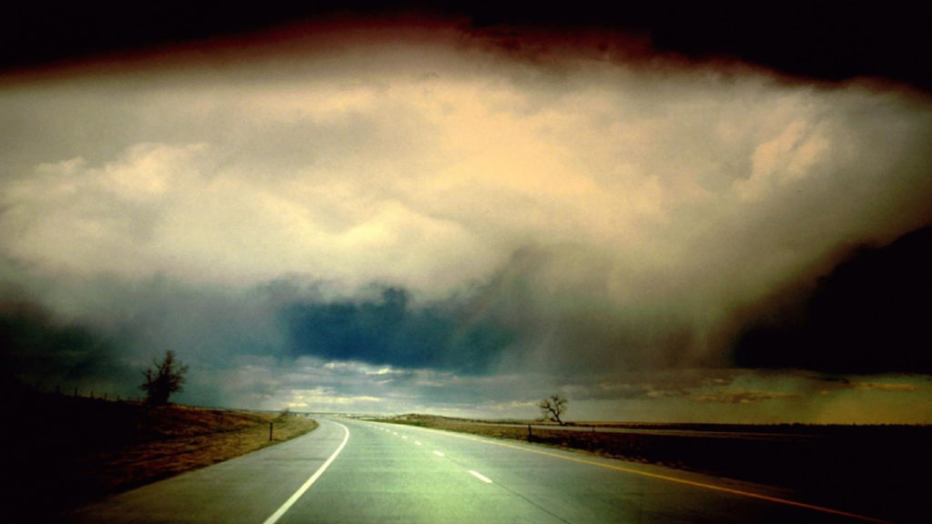 storm-clouds-over-empty-road-9516